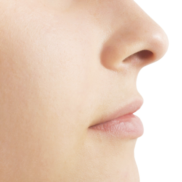Close-up woman's face with perfect skin